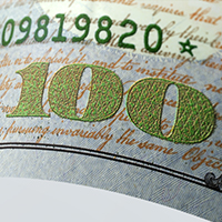A close up of the two-tone ink on the 2013 $100 bill.