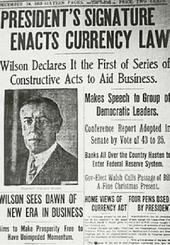 """President's signature enacts currency law,"" newspaper clipping"