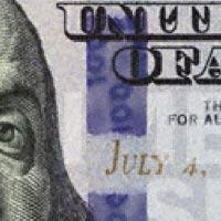 Close up of 3D security ribbon in 2013 $100 bill.